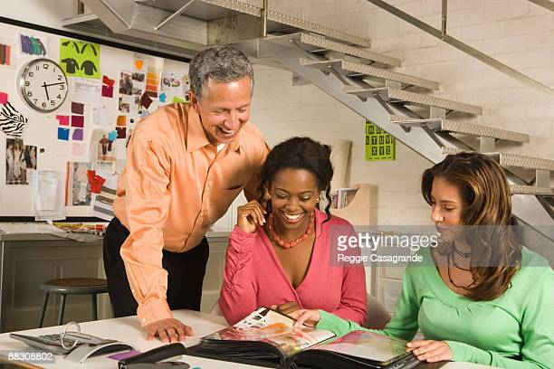 Businesswomen and businessman looking over portfolio