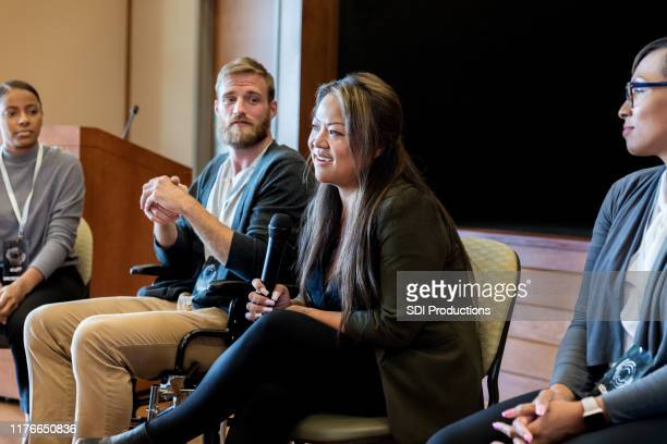 businesswomen answer questions during seminar - panel discussion stock pictures, royalty-free photos & images
