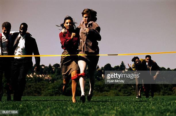 Businesswomen at a Three-legged Race Finish Line