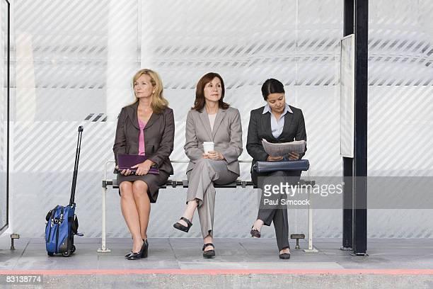 3 Businesswomen at Bus Stop