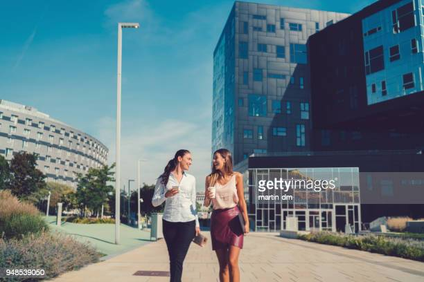 businesswomen at the office park - business community stock pictures, royalty-free photos & images