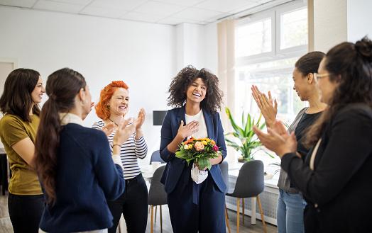 Businesswomen celebrating an achievement of a colleague - gettyimageskorea