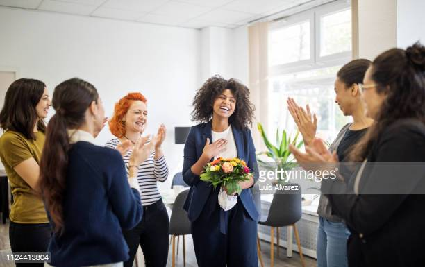 businesswomen celebrating an achievement of a colleague - 祝う ストックフォトと画像