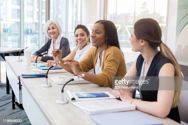 businesswomen discuss women in leadership - panel discussion stock pictures, royalty-free photos & images