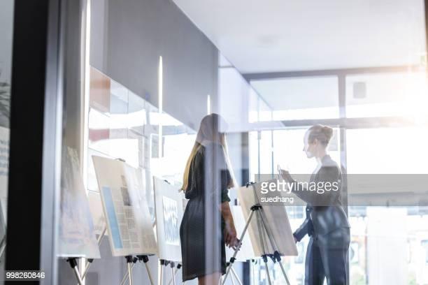 Businesswomen discussing ideas in office