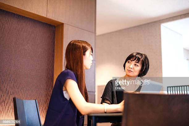 Businesswomen discussing in modern office in Japan