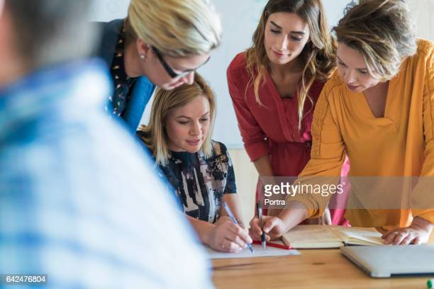 Businesswomen discussing over project in office