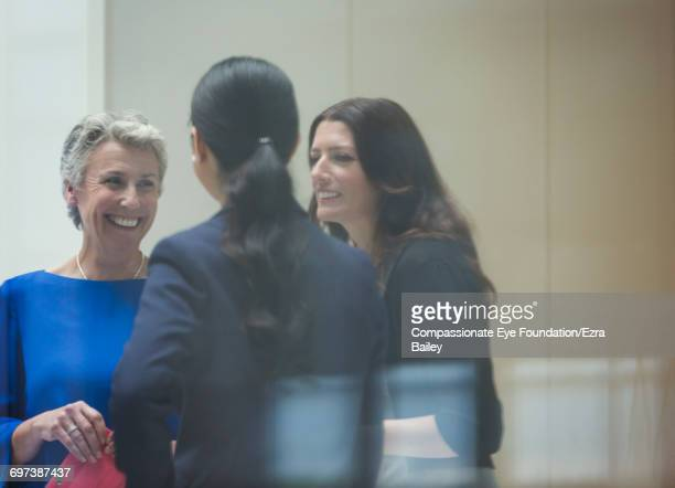 Businesswomen discussing plans in modern office