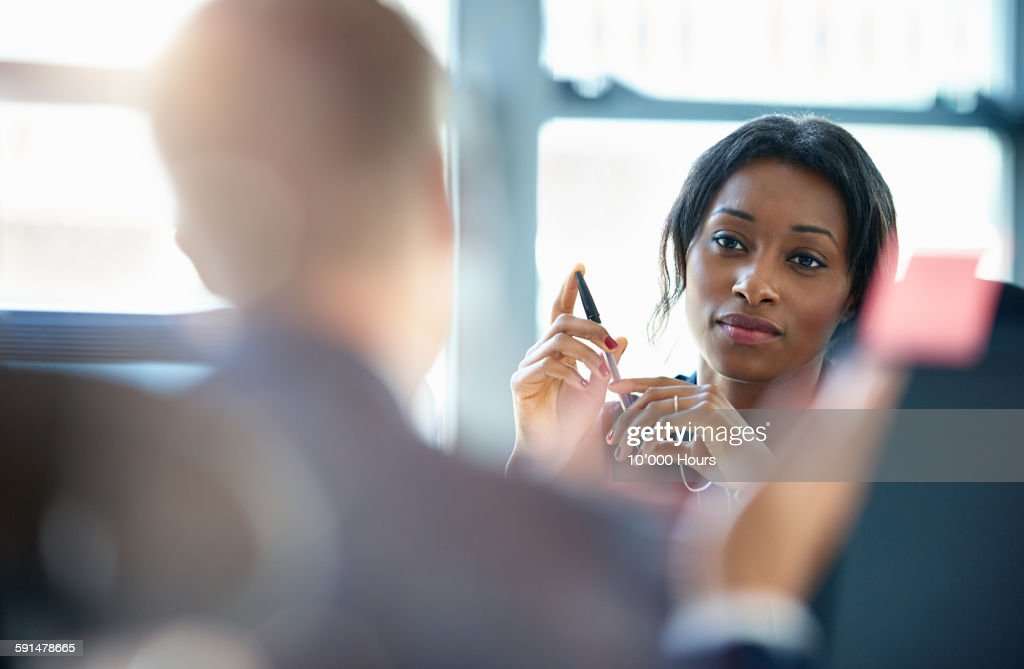 Businesswomen discussing plans with a colleague : Stock Photo