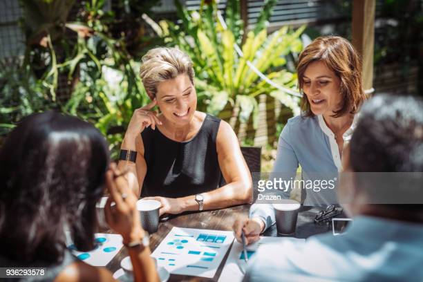 businesswomen discussing priorities and strategies - assertiveness stock pictures, royalty-free photos & images