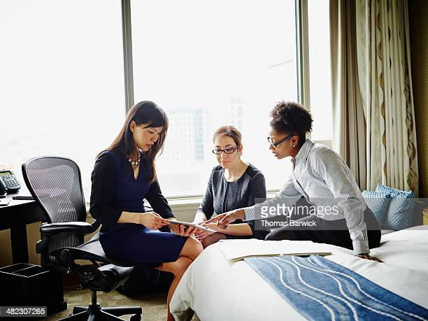 Businesswomen discussing project in hotel suite