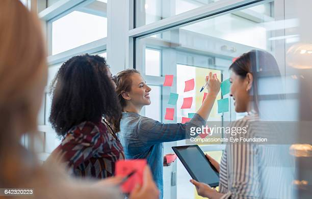 Businesswomen discussing project in office
