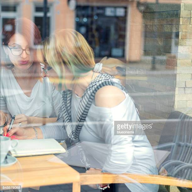 Businesswomen Having A Meeting In A Cafe