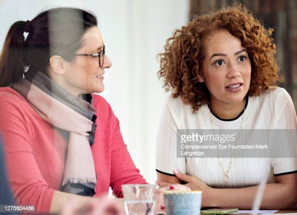 businesswomen having business meeting in office - vanguardians stock pictures, royalty-free photos & images
