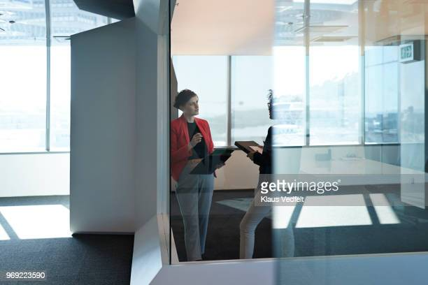 businesswomen having discussion in big corner office - focus on background stock pictures, royalty-free photos & images