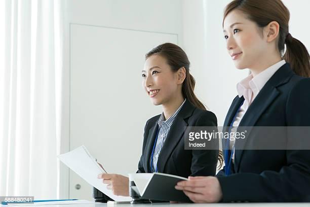 Businesswomen having interview in room