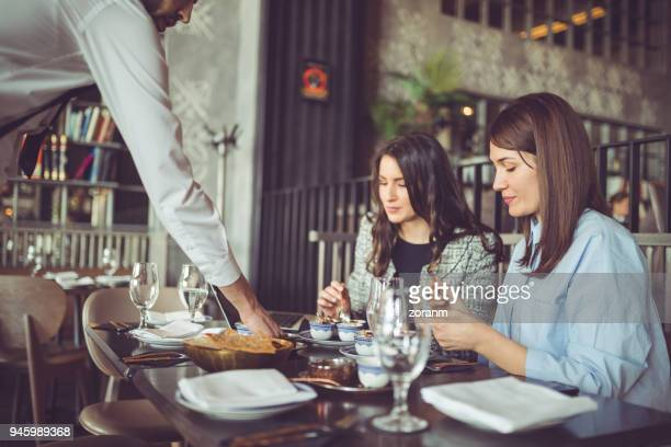 Businesswomen having lunch in restaurnat