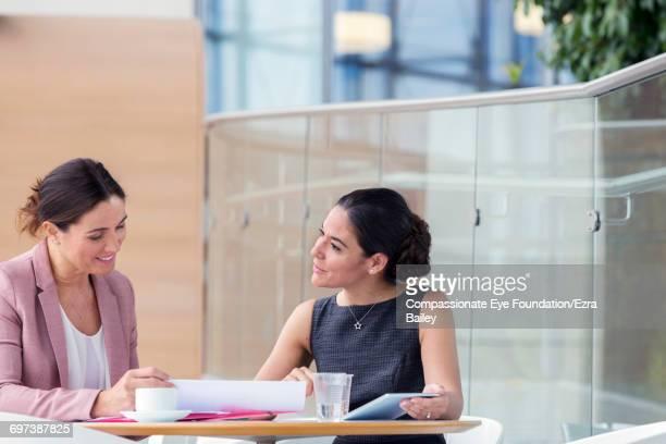 Businesswomen having meeting in cafe