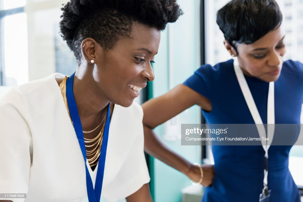 Businesswomen having meeting in modern office : Stock Photo