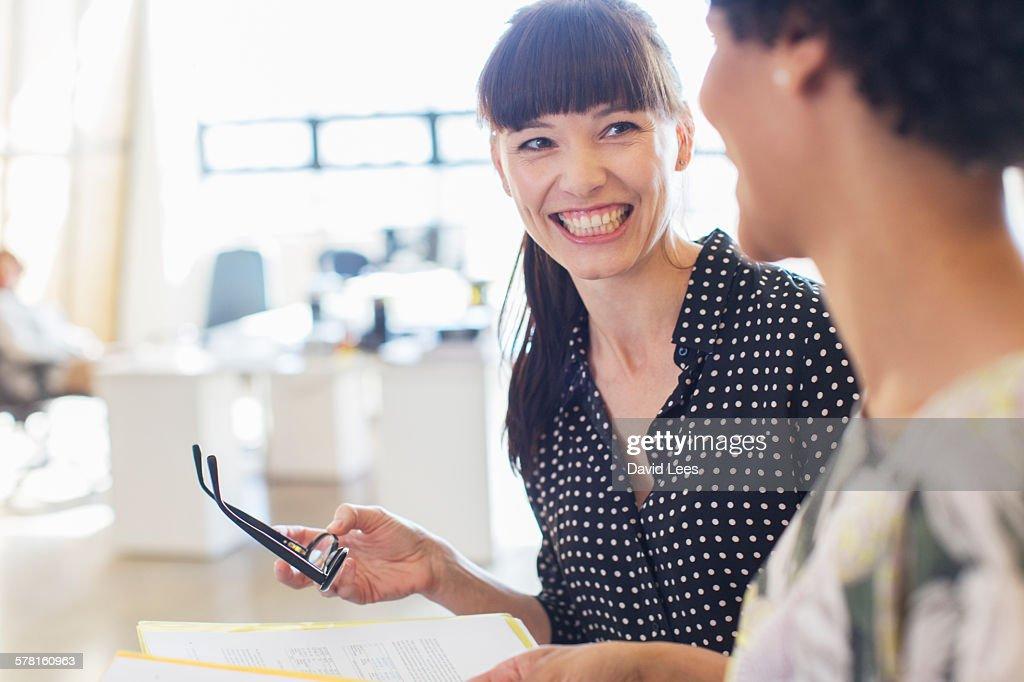 Businesswomen having meeting in office : Stock Photo