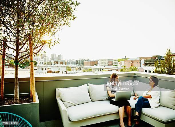 Businesswomen having meeting on office terrace