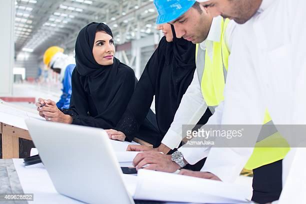 Businesswomen in a meeting with businessmen