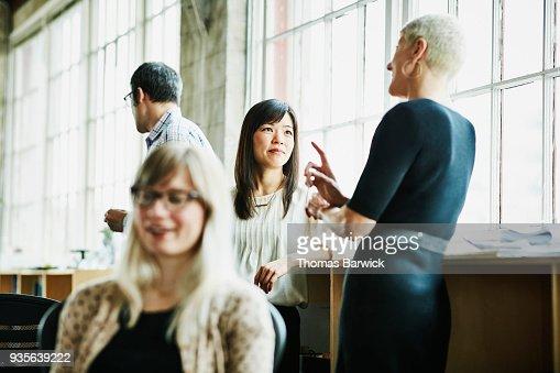 Businesswomen in discussion in design office