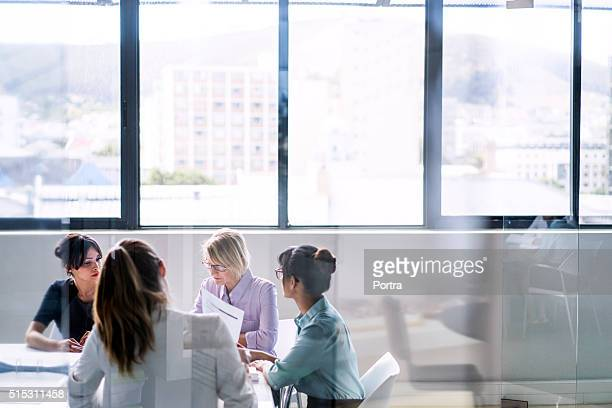 businesswomen in meeting at office - asian 50 to 55 years old woman stock photos and pictures