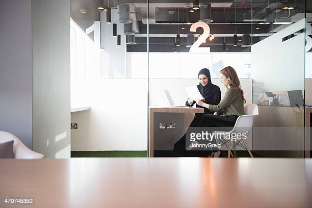 businesswomen in middle east office workplace - middle east stock pictures, royalty-free photos & images
