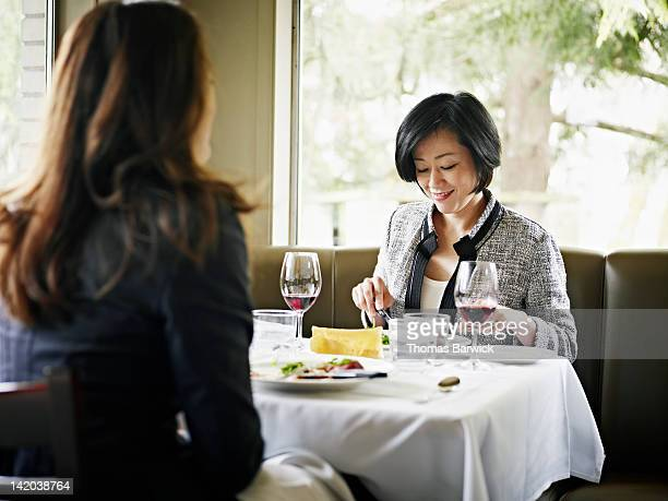 Businesswomen in restaurant eating lunch