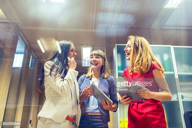 Businesswomen laughing in the office