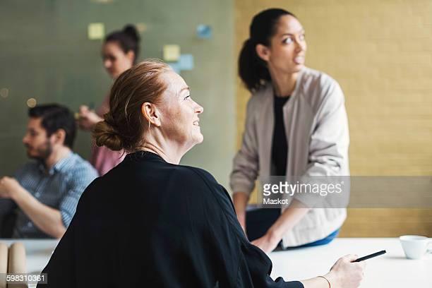 Businesswomen listening to presentation in conference room