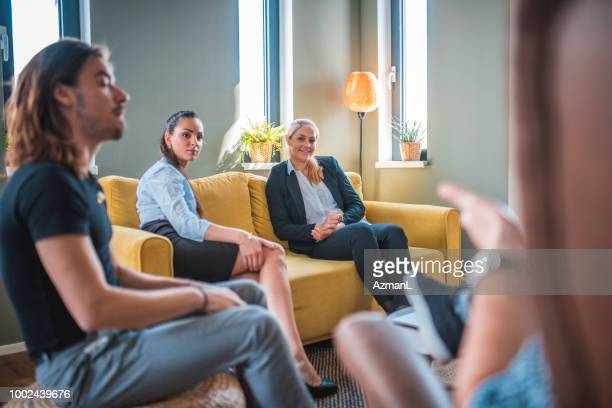 Businesswomen looking at colleague during meeting