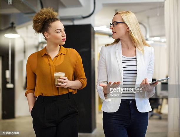 Businesswomen looking at each other white communicating