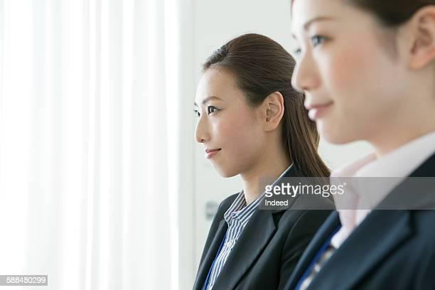 Businesswomen looking away