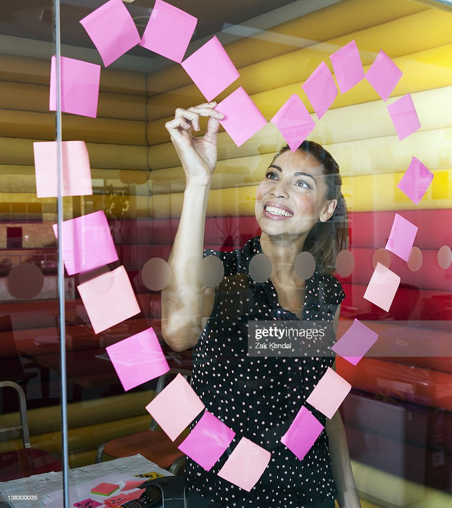 Businesswomen making heart with notes : Stock Photo