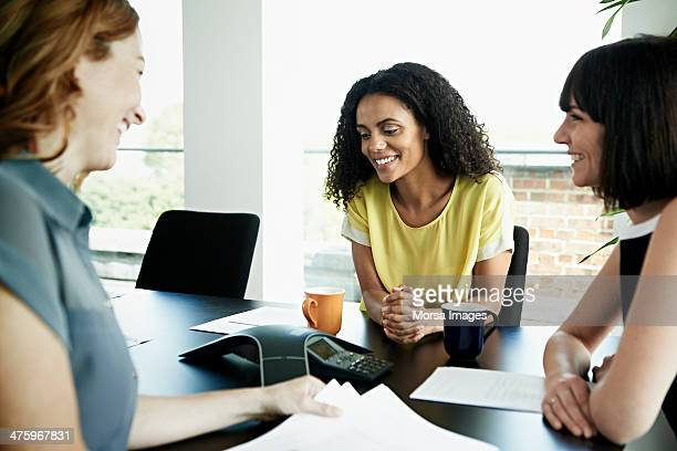 businesswomen on conference call - conference call stock pictures, royalty-free photos & images