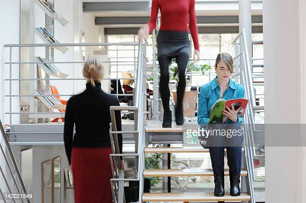 Businesswomen on steps in office