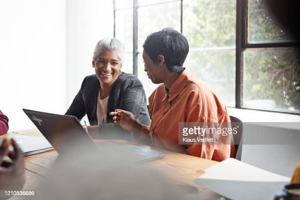 businesswomen planning in board room at workplace - business finance and industry stock pictures, royalty-free photos & images