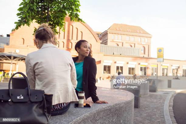 Businesswomen relaxing by central station