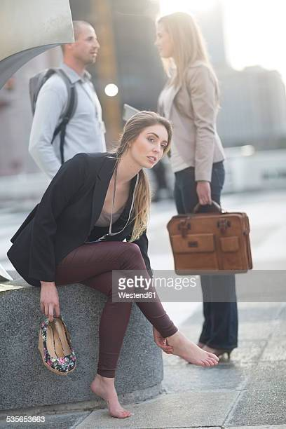 Businesswomen relaxing without her shoes