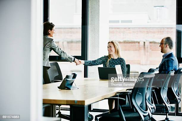 Businesswomen shaking hands after meeting