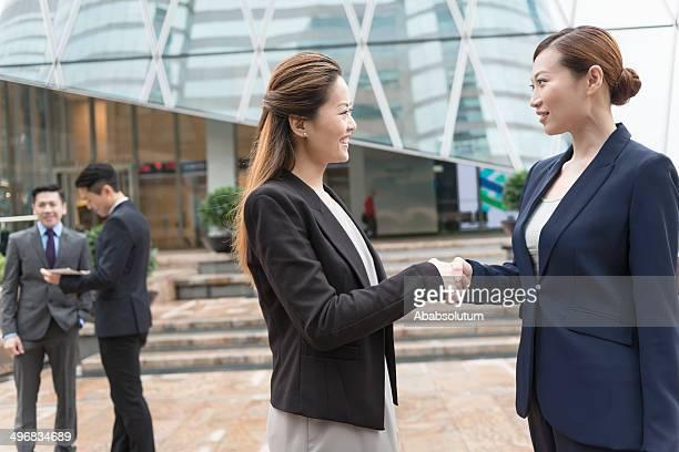 Businesswomen Shaking Hands, Hong Kong, China, Asia