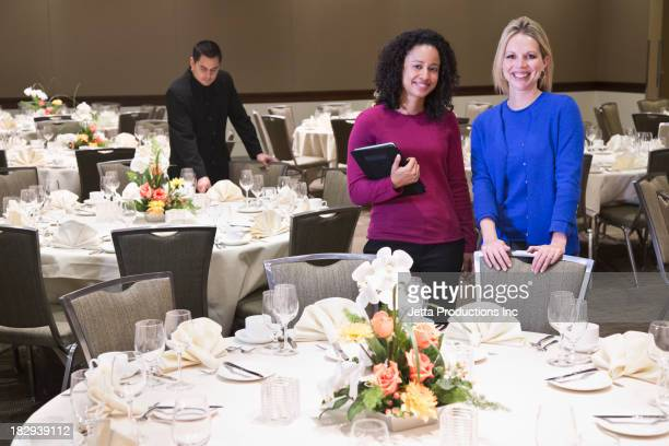 Businesswomen smiling in dining room