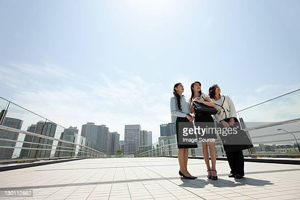 Businesswomen standing in city scene