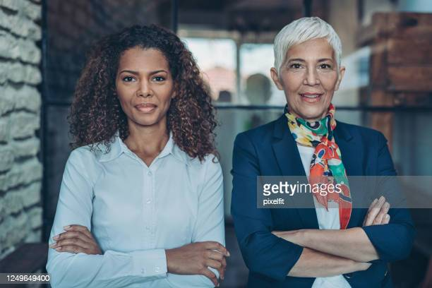businesswomen standing together side by side - social justice concept stock pictures, royalty-free photos & images