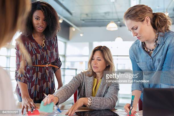 businesswomen talking in meeting - cef do not delete stock pictures, royalty-free photos & images