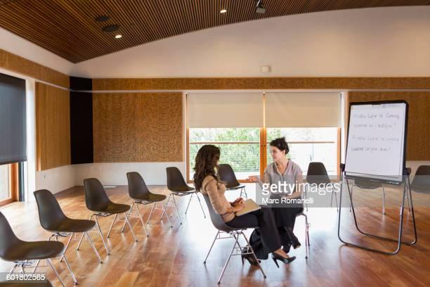 Businesswomen talking in meeting room