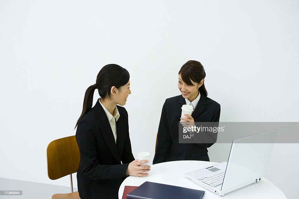 Businesswomen Talking In Office, Side View, Front View, Waist Up : Photo