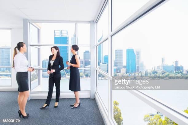 Businesswomen talking on coffee creak